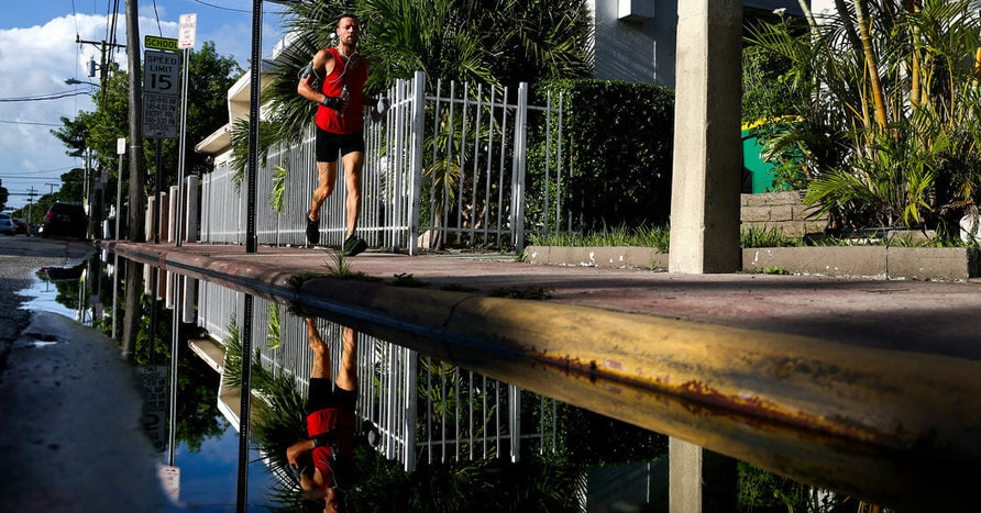 A man jogged through Miami Beach on Friday. The five new Zika cases there included two Florida residents and three people who had traveled to the area, Gov. Rick Scott said. Credit Scott McIntyre for The New York Times