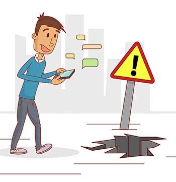 Man on phone walking into hazard