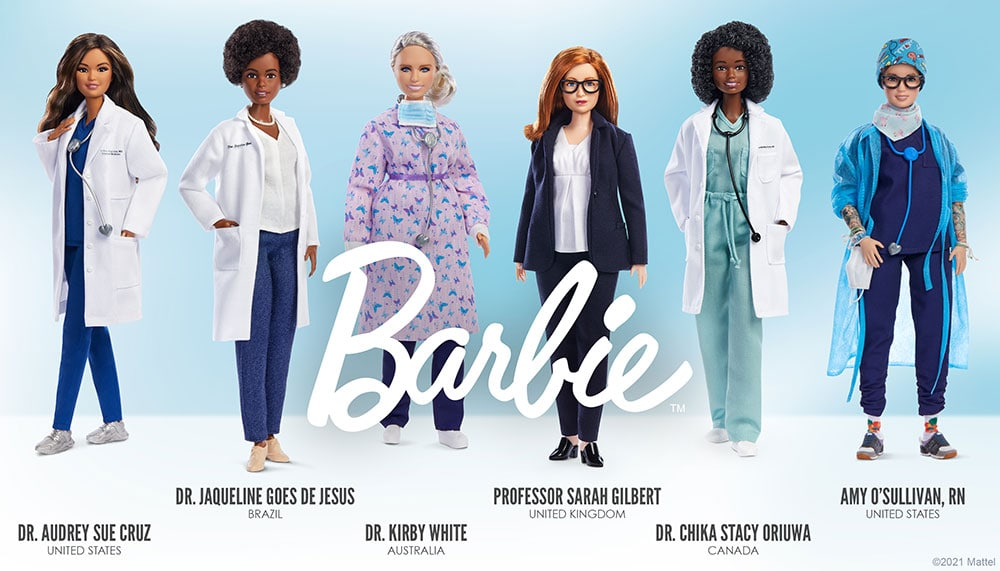 Image of 6 role model Barbies. Asian-American Barbie in white doctor coat. Text reads: Dr. Audrey Sue Cruz United States. Black Barbie in white doctor coat. Text reads: Dr. Jaqueline Goes De Jesus Brazil. White Barbie in pink surgical gown. Text reads: Dr. Kirby White Australia. White Barbie in navy suit. Text reads: Professor Sarah Gilbert United Kingdom. Black Barbie in blue-green scrubs. Text reads: Dr. Chika Stacy Oriuwa Canada. White Barbie in blue surgical coat and scrubs. Text reads: Amy O'Sullivan, RN United States.