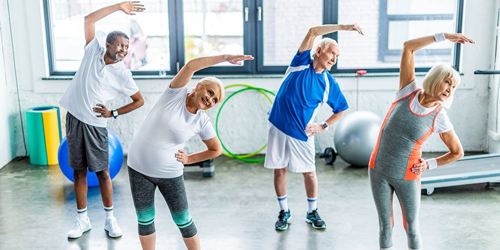 Elderly exercise group stretching